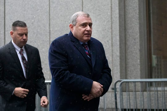 Lev Parnas, right, a Rudy Giuliani associate with ties to Ukraine, arrives for a bail hearing in federal court, Tuesday, Dec. 17, 2019 in New York.
