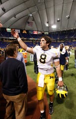 Michigan quarterback Nick Sheridan walks off the field after leading the Wolverines to a 29-6 victory over the home team Gophers at the Metrodome in Minneapolis on Saturday, November 8, 2008.