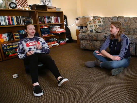 Isabella Monacelli, 14, and Emily Phillips, 16, chat during a visit to 'The Shed.'
