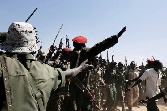 Armed rebels in support of Sudan Liberation Movement-North Leader, Adel-Aziz al-Hilu, chant slogans during a visit organized by The World Food Program (WFP) in the conflict-affected remote town of Kauda, Nuba Mountains, Sudan, Jan. 9, 2020.