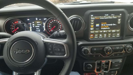 The controls for the 2020 Jeep Wrangler Ecodiesel are at close hand for cruise control, AWD transfer case and your favorite radio station.