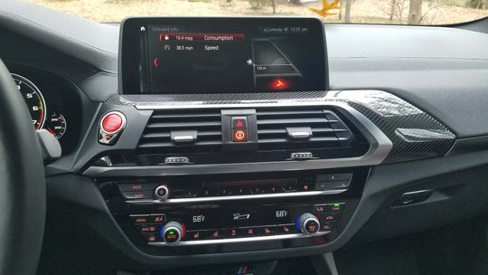 The 2020 BMW X4 M dash is a model of good ergonomics and crisp graphics.
