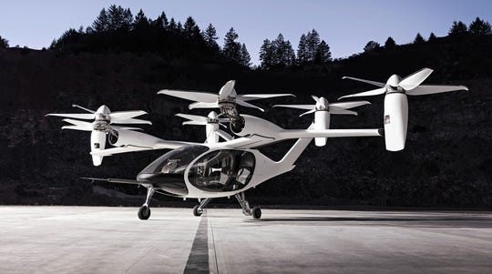 Joby Aviation's four-passenger aircraft takes off and lands vertically like a helicopter, then smoothly transitions to forward flight.