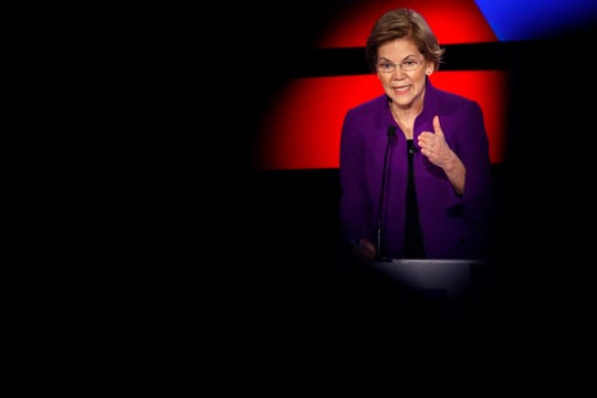 Democratic presidential candidate Sen. Elizabeth Warren, D-Mass., answers a question Tuesday, Jan. 14, 2020, during a Democratic presidential primary debate hosted by CNN and the Des Moines Register in Des Moines, Iowa.