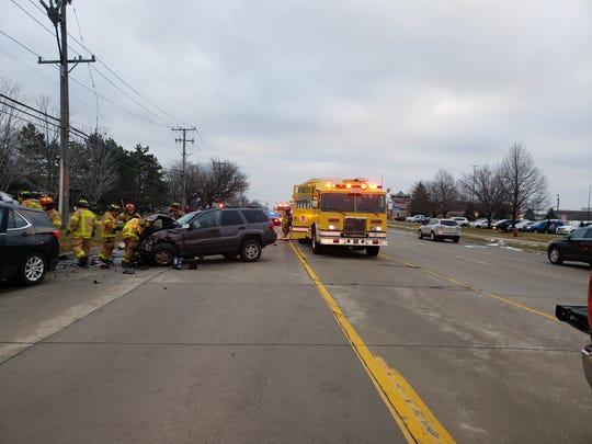Authorities said a Warren woman, 28, died in a crash on John R. near Big Beaver during rush hour Tuesday.