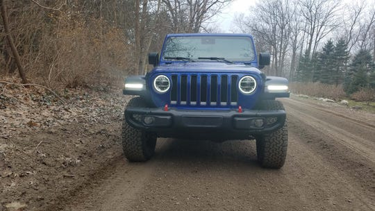 The familiar Jeep Wrangler face has changed little over the years.