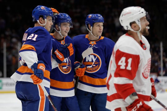 New York Islanders' Otto Koivula (21) and Matt Martin (17) celebrate a goal by Noah Dobson during the second period.