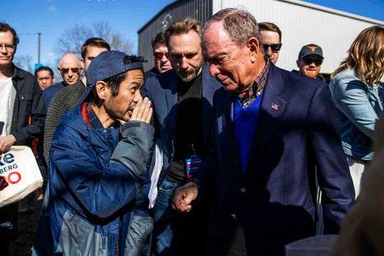 Democratic presidential candidate Michael Bloomberg listens to David Lee-Sue after his speech during his presidential campaign in Austin, Texas, Saturday, Jan. 11, 2020.