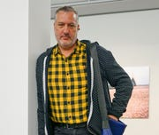 "This photo taken Oct. 3, 2019 shows artist Spencer Tunick, a photographer known internationally for his shoots assembling masses of nude people, at the FLATZ Museum in Dornbirn, Austria. The unclothed human body accounts for the bulk of the material Facebook removes from its service and activists, sex therapists, artists and sex educators say the company is unfairly censoring their work, suspending them in ""Facebook jail"" with no warning and little, if any recourse."