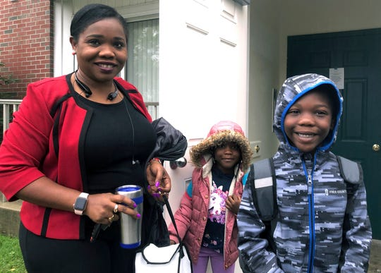 Betty Kabbashi, a medical interpreter, takes her children, Roda, 5, center, and Richie, 7, to school on Tuesday, Oct. 1, 2019, in South Portland, Maine.