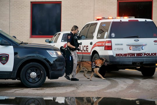 A Houston Independent School District Police K-9 unit responds to a shooting, Tuesday, Jan. 14, 2020, at Bellaire High School in Bellaire, Texas.