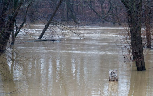 Pigeon Creek floods at the Heidelbach Canoe Launch Wednesday afternoon, Jan. 15, 2020.