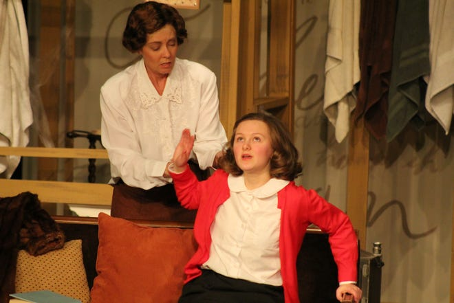 """Zoe Holland, in red sweater, portrays Anne Frank  and Laura Buchanan, left, portrays Edith Frank in the Fremont Community Theatre's upcoming production of """"The Diary of Anne Frank."""""""