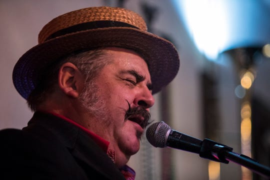 The Hot Buttered Nuggets frontman Douglas Everton performs in front of a full house Wednesday January 8, 2020 at Slate's jazz club in Cape Coral. Everton can imitate trumpets and other instruments with just his mouth and it gives this trio a unique sound.
