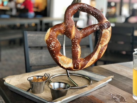 Marlins Brewhouse offers pretzels five ways, including this monster served with brown-ale beer cheese and Bavarian mustard.