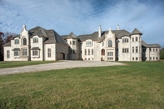 This chateau-style property at4735 Fonda Fields Court in Hobart is listed for sale for $6.9 million after it failed to sell at a Feb. 8 auction.