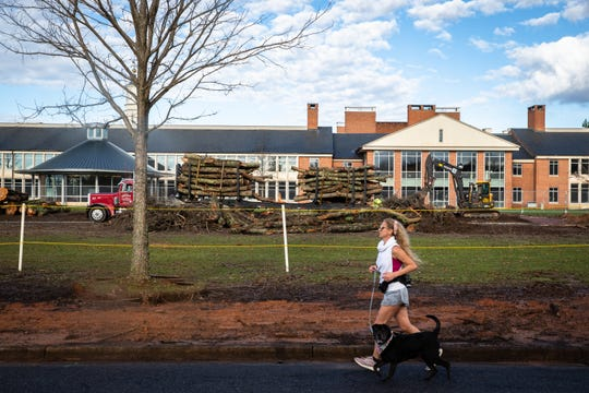 A flatbed truck with trees that have been cut down in a section of the mall at Furman University Wednesday, Jan. 15, 2020.