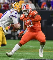 Clemson defensive lineman Tyler Davis (13) gets ready to tackle LSU quarterback Joe Burrow (9) during the first quarter at the Mercedes Benz Superdome in the National Championship football game in New Orleans Monday, January 13, 2020.