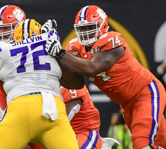 Clemson offensive guard John Simpson (74) blocks LSU defensive lineman Tyler Shelvin (72) during the second quarter of the National Championship game at the Mercedes Benz Superdome in New Orleans Monday, January 13, 2020.