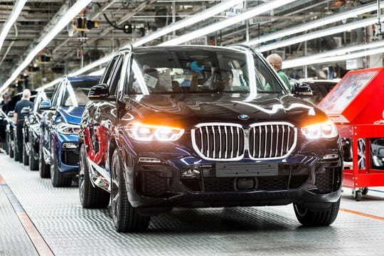 In this file photo from 2018, line workers assemble a BMW X5 at the German manufacturer's plant in Spartanburg County.