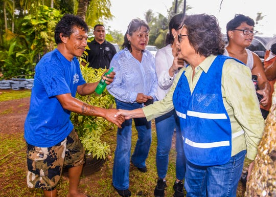 Dededo resident, John Mesa, left, shakes hands with Gov. Lou Leon Guerrero after receiving a bottle of insect repellent outside his home along Swamp Road on Wednesday, Jan. 15, 2020. Five thousand pump spray bottles of the repellent was donated by the CDC Foundation and shipped to Guam by SC Johnson to help residents protect themselves from the recent outbreak of the dengue virus, according to the Department of Public Health and Social Services.