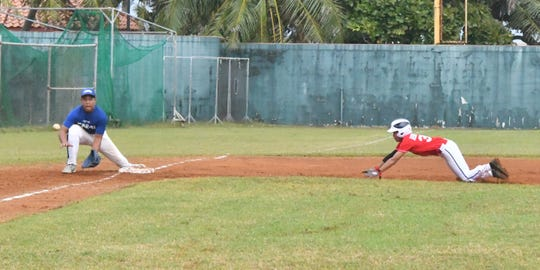 CNMI third baseman Joey Sharry gets ready to tag out Guam baserunner Keoni Raguindin in their WBSC Oceania Qualifier baseball game Jan. 15 at the Paseo Stadium. Guam won the game 9-5.