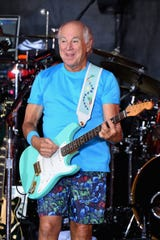 Jimmy Buffett performs using a guitar strap created by Action Custom Straps on July 29, 2016, in New York City.