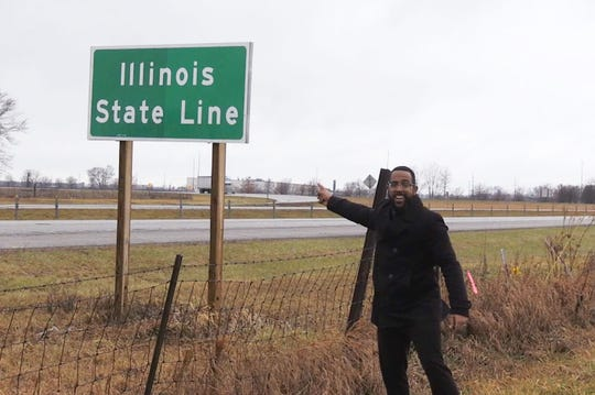 Justin Mack, standing at the Indiana-Illinois state line.