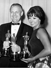 """In this April 9, 1962 file photo, Oscar winners for """"West Side Story,"""" Robert Wise and actress Rita Moreno, pose at the Academy Awards in Santa Monica, Calif."""