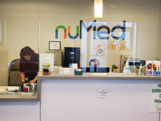 Staff members working the front desk of NuMed Urbana on Friday, Jan. 10, 2020.