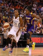 Eastern Conference All-Star Tamika Catchings #24 of the Indiana Fever controls the ball past Western Conference All-Star Nneka Ogwumike #30 of the Los Angeles Sparks during the WNBA All-Star Game at US Airways Center on July 19, 2014 in Phoenix, Arizona. Qgwumike took over as WNBPA President for Catchings in 2016.