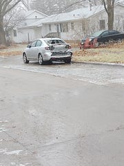This car parked in south Iowa City was hit twice in one morning: Once by Ren Wallace, and once, minutes earlier, by Wallace's boss. It was one of many cars involved in a crash due to slick roads on Jan. 15, 2020.