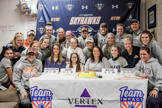 Jada Watson, 12, and her mother, Billie, pose for a photo with the UTM softball team after her signing ceremony on campus Monday.