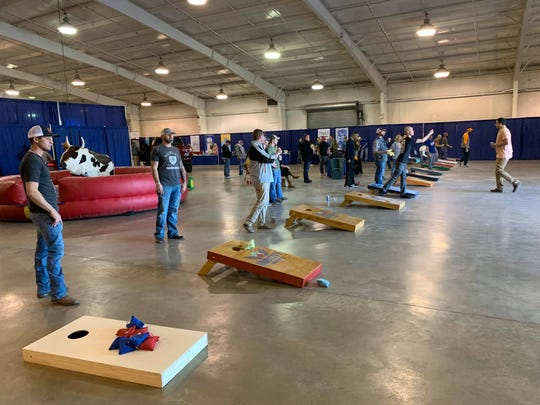 Cornhole boards line one side of the Fairgrounds Arena during last year's Guns & Hoses event. The cornhole tournament returns this year.