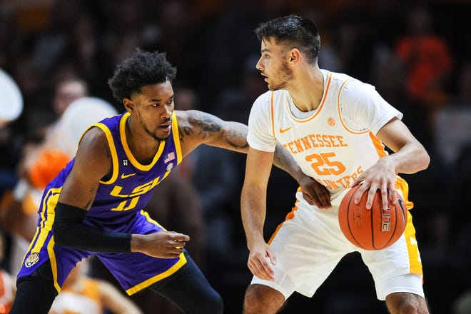 Jan 4, 2020; Knoxville, Tennessee, USA; Tennessee Volunteers guard Santiago Vescovi (25) being guarded by LSU Tigers guard Charles Manning Jr. (11) during the second half at Thompson-Boling Arena. Mandatory Credit: Bryan Lynn-USA TODAY Sports