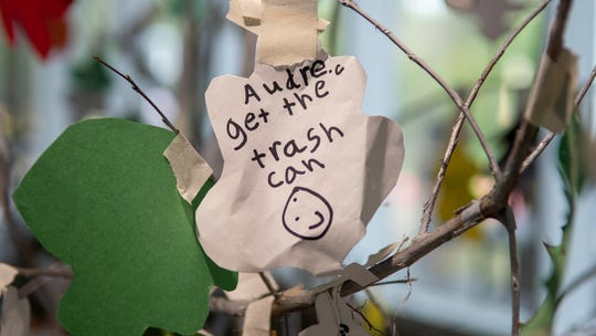 Notes left on the tree inside of the school part of the Let Grow program.