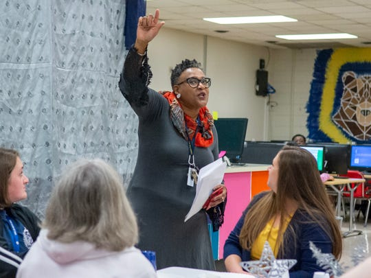 Juanita Hall, a teacher at Carencro Middle talks with the sutdents attending the Leader in Me breakfast Friday, Jan. 10, 2020.