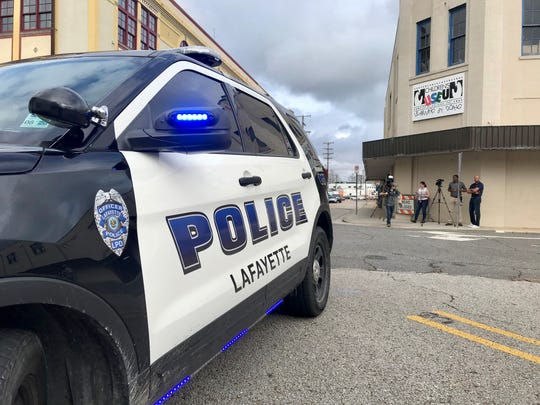 Police respond to reports of a suspicious person in downtown Lafayette Wednesday. An all-clear was given at around noon.