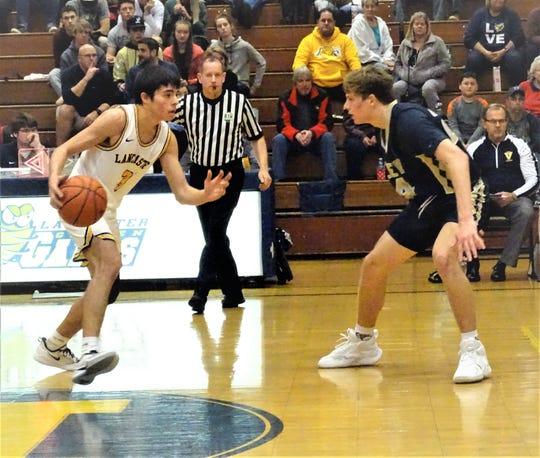 Lancaster senior guard Deven Savage finished with 15 points to help lead the Golden Gales to a 61-46 non-conference win over Teays Valley Tuesday night.