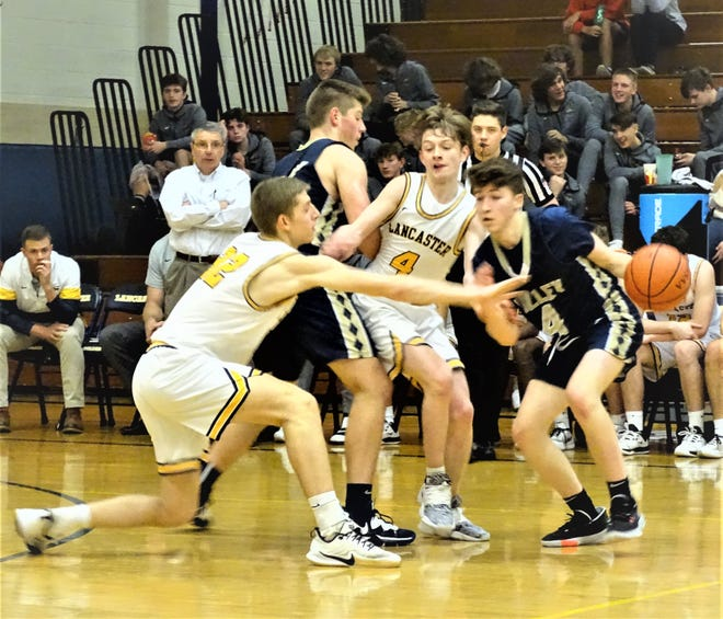 Lancaster's Dylan West and Tanner Roush plays solid defense against Teays Valley Tuesday in a non-conference game. The Golden Gales used a strong fourth quarter to pull away for a 61-46 win.