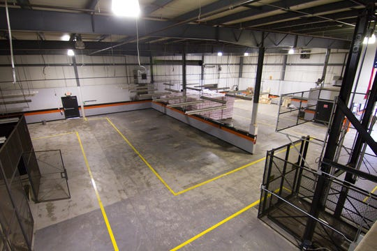 Space earmarked for Pure Energy Window Company's future warehouse is seen Wednesday, Jan. 15, 2020 from the mezzanine of the former Brighton Harley-Davidson dealership in Brighton Township.