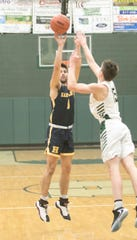 Hartland's Kyle Hamlin, who scored a game-high 21 points, makes a 3-pointer over Howell's Griffin Smith on Tuesday, Jan. 14, 2020.