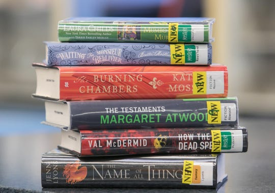 A number of new books at the Howell Carnegie District Library, shown Wednesday, Jan. 15, 2020, make for popular reads.