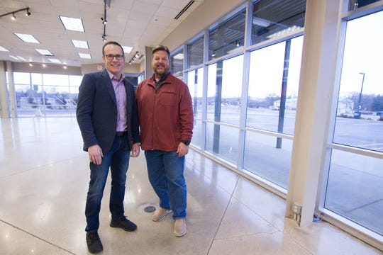 Adrian Beaver, left, and Matt Masters will relocate their business Pure Energy Window Company to the former Brighton Harley-Davidson building in Brighton Township. They will eventually replace the building's many windows with their own high-energy efficiency products.