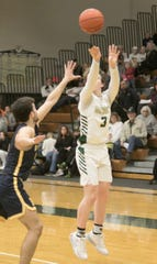 Howell's Will Hann hits a 3-pointer on his way to a team-high 17 points in a 51-44 victory over Hartland on Tuesday, Jan. 14, 2020.