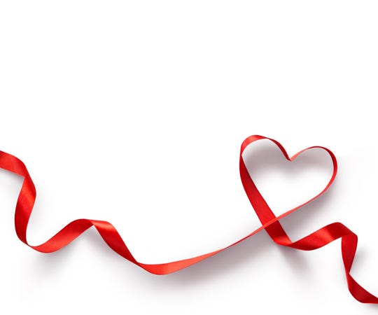 Getty Images/iStockphoto Happy Valentines Day. Red Ribbon Heart on white background. Valentines Day concept