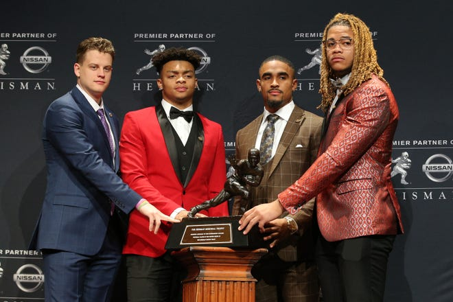 Eventual winner Joe Burrow (far left) and Justin Fields (second from left) share the Heisman Trophy stage with fellow finalists Jalen Hurts and Fields' Ohio State teammate Chase Young.