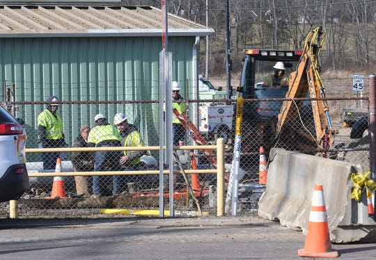 Columbia Gas workers make repairs to the station at U.S. 42 and Hanley Road on Wednesday.