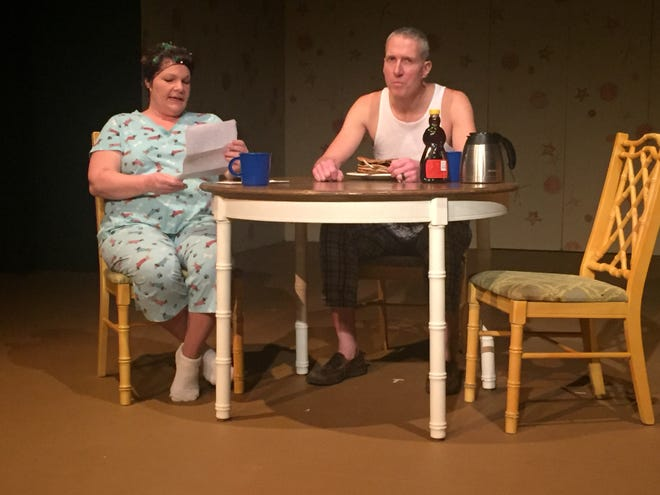 """Jodi McCall and Greg Brandes rehearse a scene from """"Dearly Departed,"""" the latest production from the Mansfield Playhouse."""