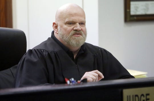 Judge John L. Good addresses the court during the sentencing of former Hillsdale Schools teacher Robert Altenburger on his voyerism charges Tuesday in Municipal Court.